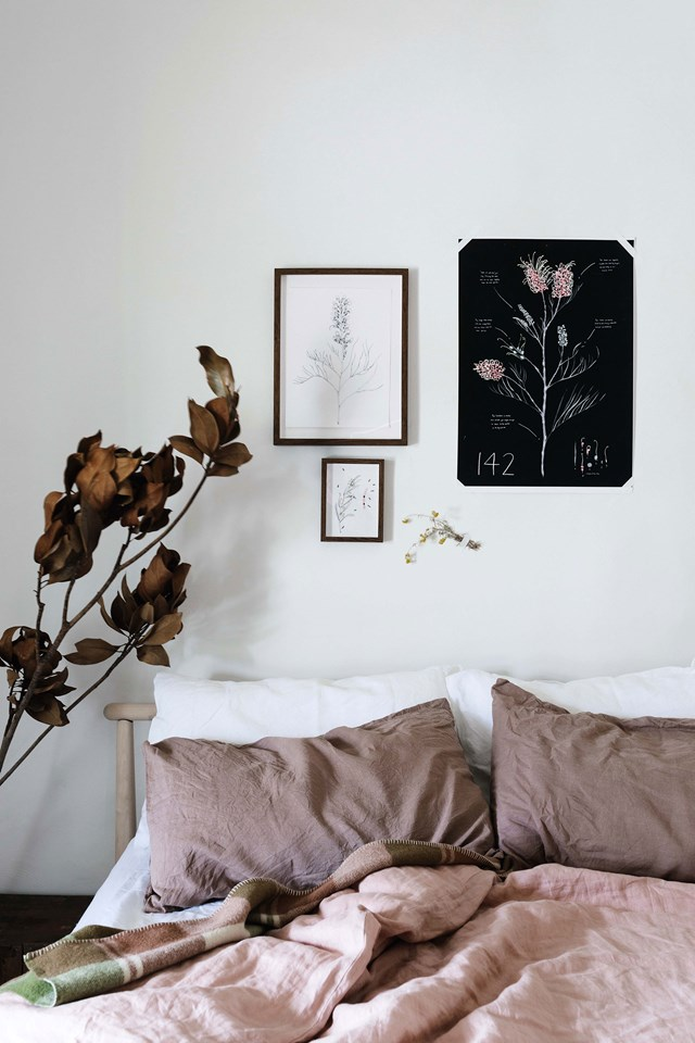 Let the season inspire your decor. Here, dried autumnal foliage, botanical illustrations and bedlinen in soft tones that you would would commonly see on an early winter morning or late afternoon, make this bedroom feel calm and connected.