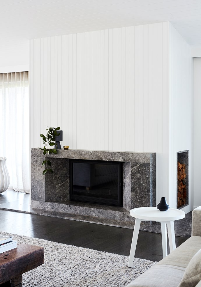 A Flinders Coast retreat offers the best of beach and country for its owners. Stone fireplace surround in Grey Aether from G-Lux. *Photograph*: Sean Fennessy | *Styling*: Jessica Lillico. From *Belle* June/July 2018.