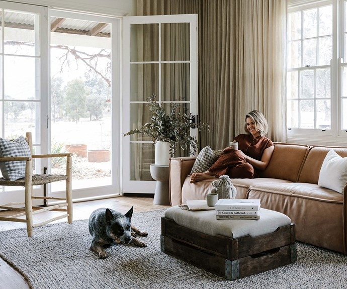 Edwina Bartholomew in the living room of her holiday home in the Blue Mountains