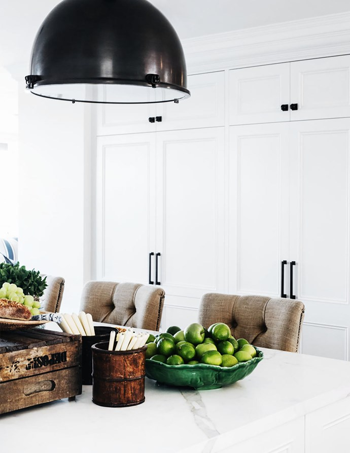 Sydney-based designer Lynda Kerry adds bowls of green apples and cutlery in oriental containers to her benchtops for instant warmth and rustic modernity in her harbourside eastern suburbs kitchen.