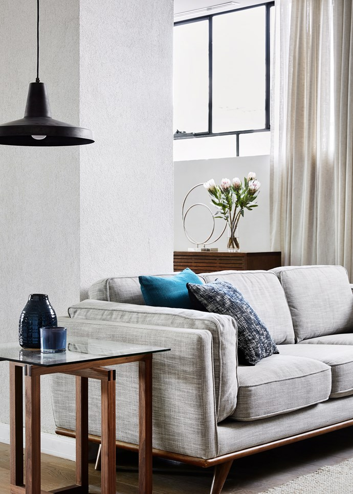 "**Get the lighting right:** [Lighting](https://www.homestolove.com.au/home-lighting-tips-4375|target=""_blank"") is so important in a living room, so make sure it's something you consider carefully when planning your space. Think about what you'll use the room for: is it just for watching TV, or will you read there, too, and play board games, or entertain? If so, think about the areas where this is likely to happen, and plan the lighting accordingly. *Photo:* Tess Kelly / *bauersyndication.com.au*"