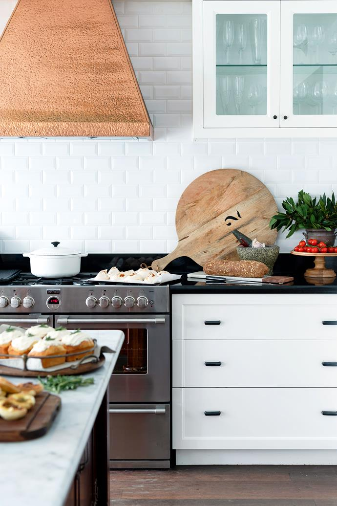 "When in doubt, decorate with food. A country kitchen with French flair should never feel sterile. Don't be afraid to store things like timber chopping boards out on the bench. No budget for a statement copper rangehood? No worries! Decorate with copper pots and pans instead. Take style notes from this kitchen in a [restored Arts and Crafts style home](https://www.homestolove.com.au/florists-home-and-studio-19731|target=""_blank""). *Photo: Jody D'Arcy / Story: Australian House & Garden*"
