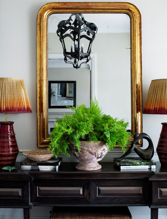 """**Styling by Lisa Burdus** <p> HEIRLOOM HERO: console table<p> """"My clients wanted to refresh the entry of their home. They decided to keep the console, which was purchased overseas, as it fits the space well and they didn't see any reason to replace it. I added soul to the space with an antique mirror and lamps with textured shades, styling it up with sculptures from the couple's collection, books and a lush pot plant.""""  <br></br> *Console, sculpture and pendant light, clients' own. Mirror, Maison et Jardin. Lamp bases, Penny Morrison (UK), with bespoke lamp shades by Lisa Burdus Design & Decoration. Pot plant and vase, Parterre. Photograph*: Brigid Arnott. Crows Nest, NSW; [lisaburdus.com.au](https://lisaburdus.com.au/