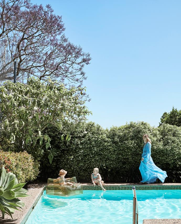 While homeowner Lill entertains guests poolside, her daughters prefer to play in the solar-heated pool.