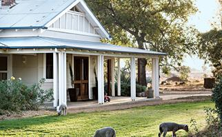 Weatherboard country farmhouse with wrap around verandah