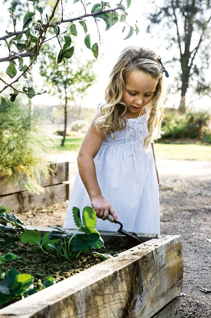 Five-year-old Catherine enjoys a spot of gardening.