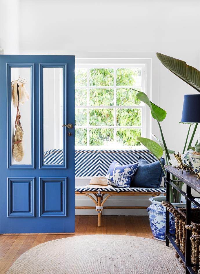 "Glazed door panels give visitors a glimpse of the [home's breezy decor](https://www.homestolove.com.au/hamptons-style-home-in-coastal-victoria-6266|target=""_blank""). *Photograph*: Martina Gemmola 