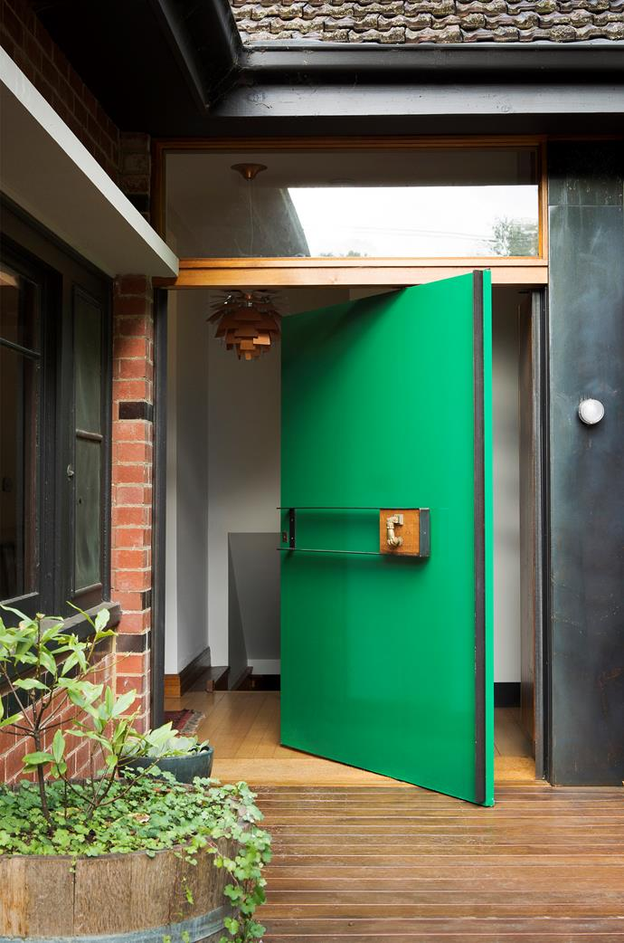 "Tucked around corner and not visible from the street, the [front door](https://www.homestolove.com.au/vibrant-home-interior-in-melbourne-by-multiplicity-5756|target=""_blank"") is a nice surprise for people once they reach it. It has been painted in Wattyl 'Wild Mint'. *Photograph*: Stephen Crafti."