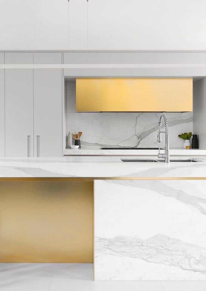 Calacatta marble from Nefiko Marble. Stainless steel in Quartz Champagne Mirror finish from Rimex Metals. Metalwork Gold rangehood cover, recessed handles, gold bar benchtop and gold box to the back of island by All Metal Projects, all electroplated in Pagasi Gold by Astor Metal Finishes.