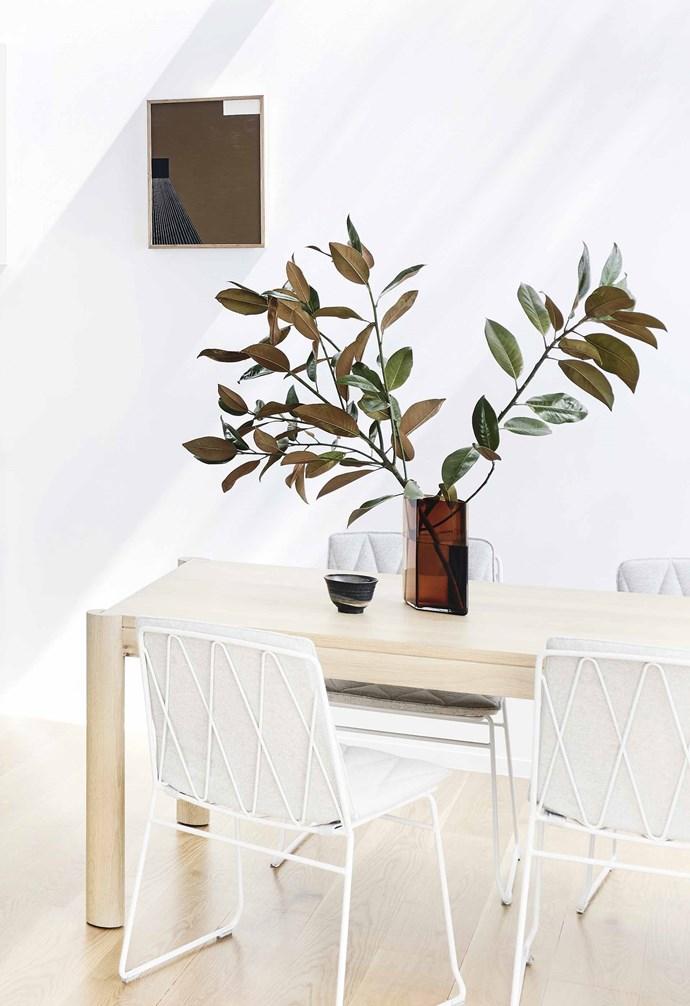 "**Side by side** The dining area is placed next to the kitchen space. 'Ruuto' Iittala vase, [Open Room](https://www.openroom.com.au/ target=""_blank"" rel=""nofollow""). Vessel, [House of Orange](https://www.houseoforange.com.au/ target=""_blank"" rel=""nofollow""). Artwork: *Your Turn* by Kasper Raglus, [Modern Times](https://www.moderntimes.com.au/ target=""_blank"" rel=""nofollow"")."