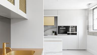 A modern kitchen with gold and grey accents