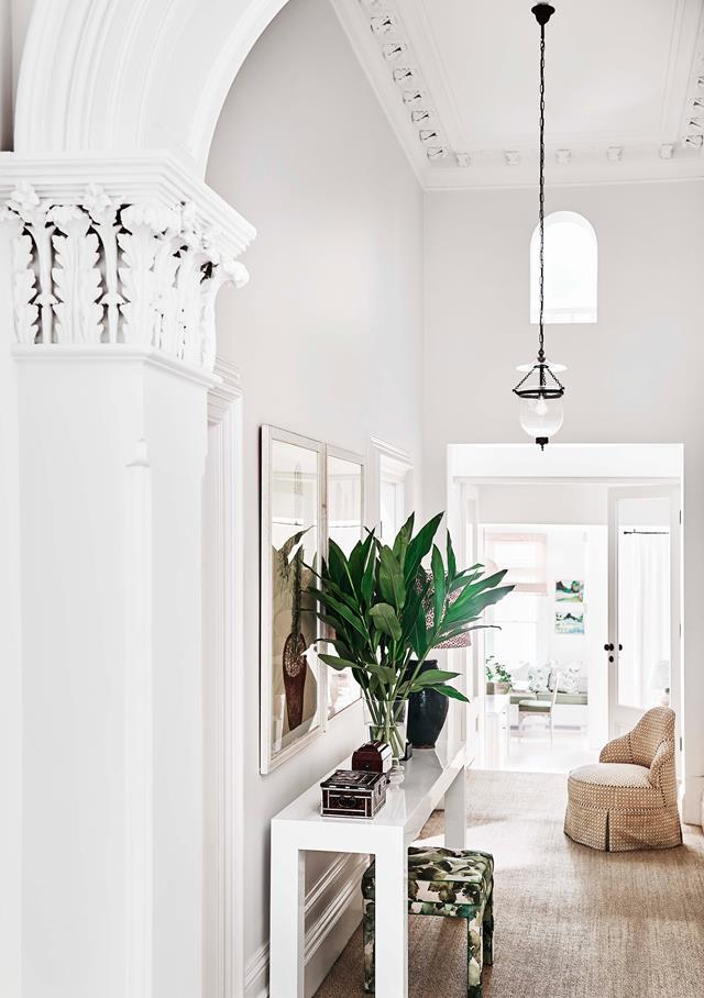 "Barely touched since the 1800s, a [handsome Victorian house](https://www.homestolove.com.au/adelaide-braggs-restored-victorian-home-19113|target=""_blank"") in a leafy Melbourne suburb has a newfound sense of lightness thanks to a robust renovation by Adelaide Bragg. In the hallway, the home's original tessellated flooring lays protected beneath a neutral rug. The stool has been upholstered in fabric from Tigger Hall Design."