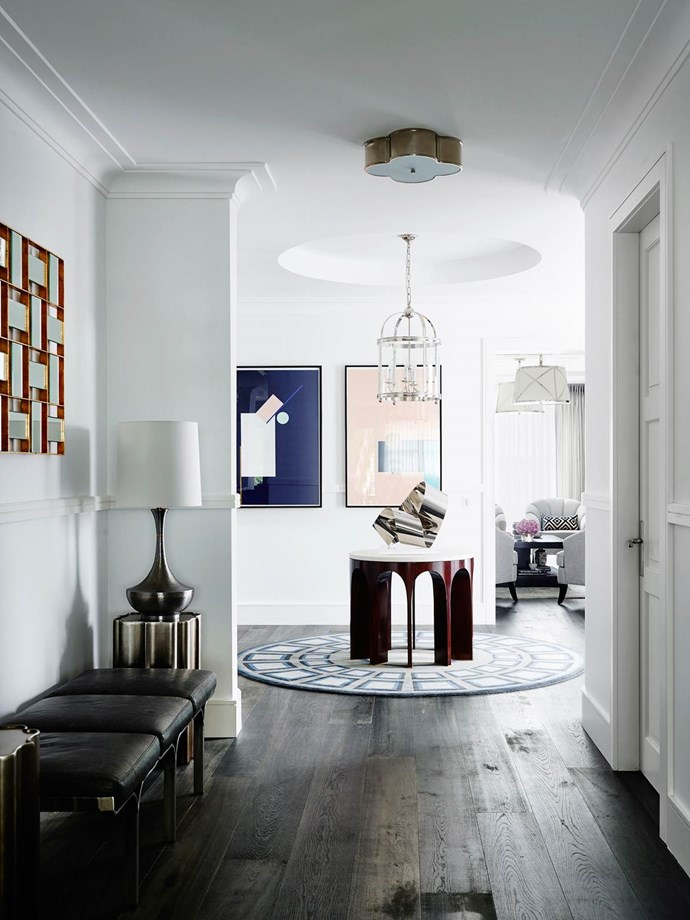 """Designer Greg Natale modified his signature exuberant style to deliver a [pared-back aesthetic](https://www.homestolove.com.au/sydney-art-deco-home-by-interior-designer-greg-natale-4648