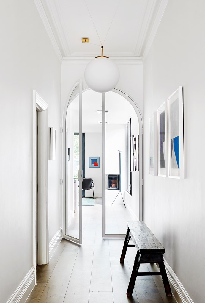 Kathryn Robson and Chris Rak's Melbourne home is an exercise in restraint and pure good taste. Artworks by Chris Connell in the hallway, which looks through to a Caspar Fairhall painting. *Photograph*: Shannon McGrath. From *Belle* February/March 2019.