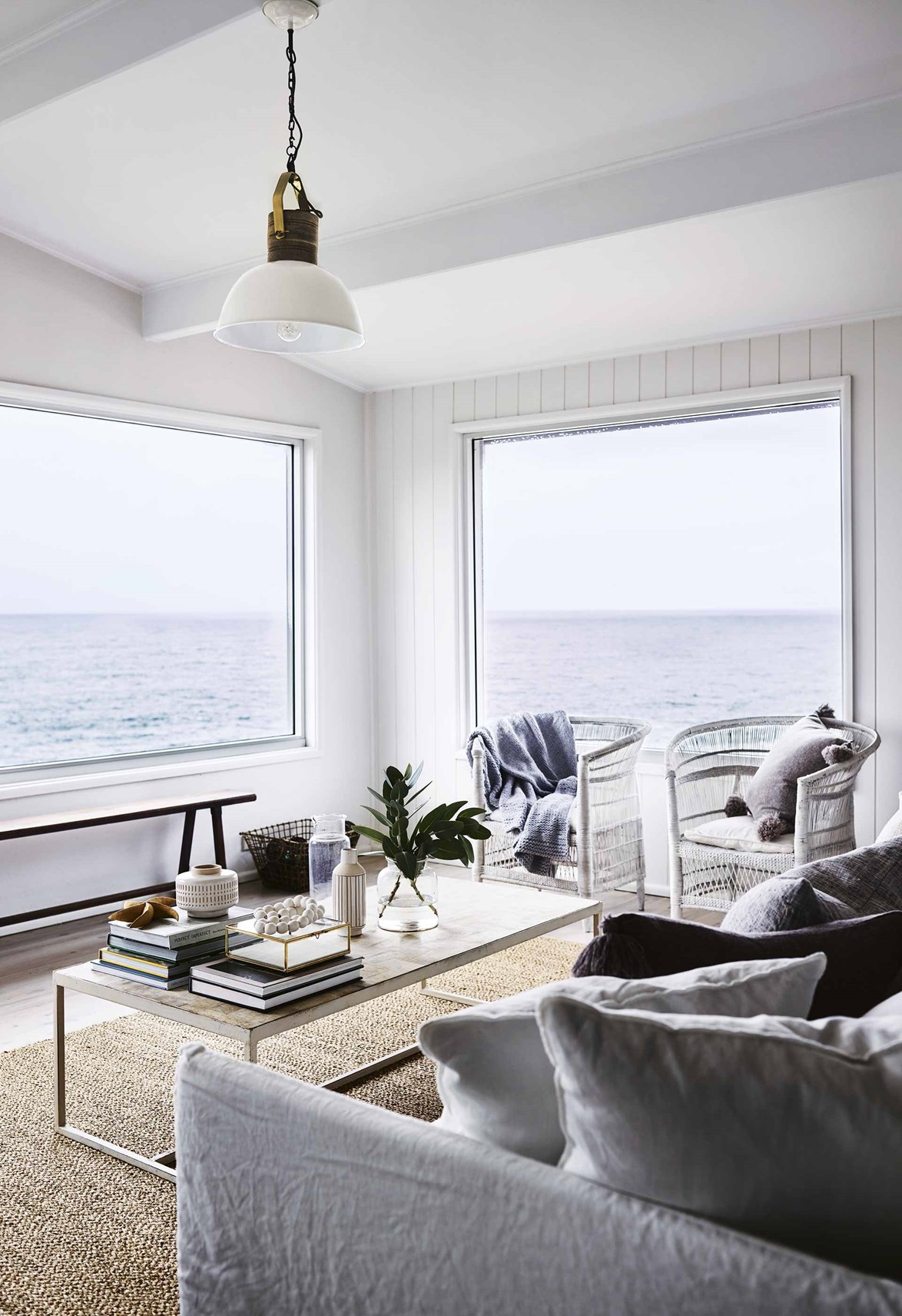 "**Cliff House, Mollymook, NSW**<br> When you envision an ideal beach house, uninterrupted ocean views are a must. This is exactly what this beautiful [beach house in Mollymook](https://www.homestolove.com.au/beach-house-mollymook-16946|target=""_blank"") delivers in spades. With its modern coastal aesthetic and huge picture windows that allow you to look out over the ocean and thoughtful styling touches throughout, Cliff House has everything you need for a relaxing seaside getaway. Be sure to [explore Mollymook and nearby Ulladulla >](https://www.homestolove.com.au/mollymook-and-ulladulla-where-to-eat-and-shop-10380