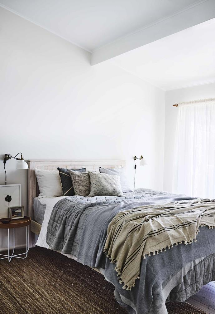 """**Think outside the box** """"We also brought a seagrass hula skirt back from a trip to Fiji and mounted that on the wall in the lounge room – it's now one of my favourite walls. Making the decorations like this meant we got exactly what we wanted at an inexpensive cost.""""<br><br>**Master bedroom** [Sheridan](https://www.sheridan.com.au/