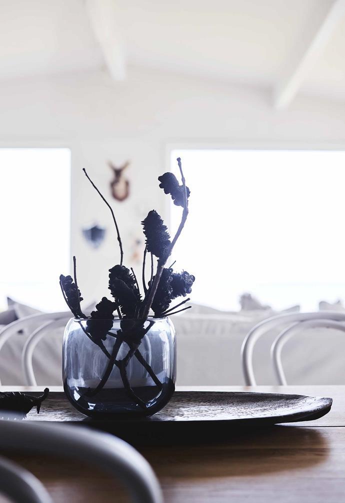 "**Dining table** Sculptural branches add interest to a [Città](https://www.cittadesign.com/|target=""_blank""|rel=""nofollow"") vase."