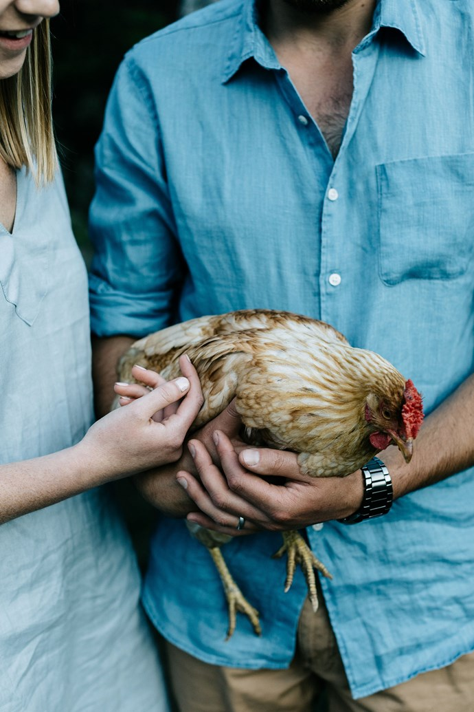 """The couple holding [one of their hens](https://www.homestolove.com.au/backyard-chickens-9470 target=""""_blank""""). Boz, 29, is also Huon born and bred. """"Boz's family had one of the biggest apple orchards, and I knew his stepsisters really well, but I didn't meet him until I was about 13. We were always in the same group, so we kept in contact, and we would see each other when we were out and about,"""" she says. """"We got together nine years ago, and we've been married for two."""""""