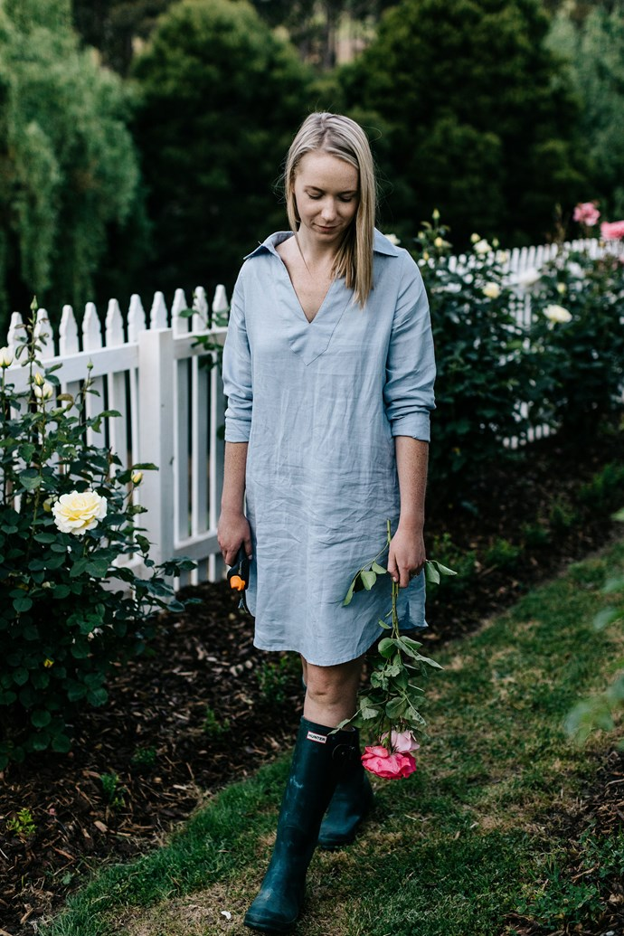 """Laura picking garden roses. """"Our family had a cattle farm at a place called Surveyors Bay, near the southern town of Port Huon, and I lived there until I was four or five. Then we moved to Huonville while my two brothers were away at high school in Hobart,"""" says Laura."""