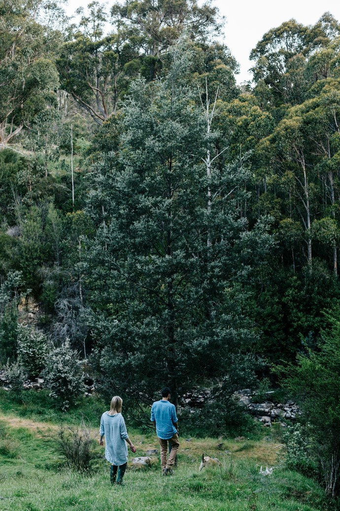 """Laura and Boz going for a wander through the property's [rambling wild garden](https://www.homestolove.com.au/a-rural-property-in-central-victoria-6355 target=""""_blank""""). Their favourite time is when they're in the garden, pottering about with their animals. """"I like to sit on the deck and talk to the chickens,"""" says Laura. """"We'll be here forever — even though, perhaps, I should never say never."""""""