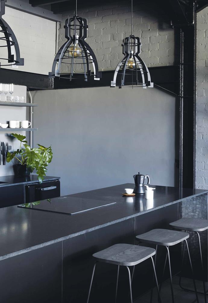 **Kitchen** The trio of industrial-style pendants add a warehouse aesthetic to the home.