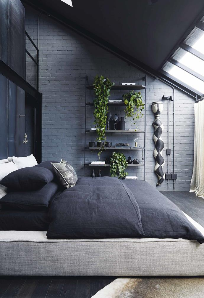 **Bedroom** The monochrome scheme continues in Kim's bedroom, as does the and sense of spaciousness thanks to big sliding doors and skylights. She isn't a fan of built-in closets so she had the steel and wood shelf custom made. Her bed was also made locally.
