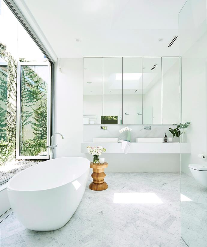 Making the most of its parameters, this contemporary bathroom has used floating vanities and a glass shower screen to create the illusion of even greater space. *Image: John Paul Urizar / bauersyndication.com.au*