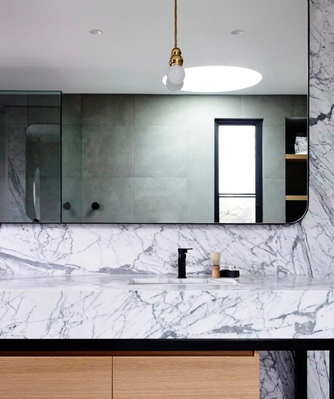 Textured marble has been used for both the splashback and vanity in this contemporary bathroom to create a dramatic feature point. *Image: Derek Swalwell / bauersyndication.com.au*