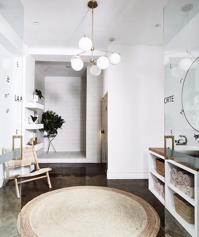 The clean lined, bright white contemporary bathroom calls for a statement pendant light to illuminate the room.  *Image: Kristina Soljo / bauersyndication.com.au*