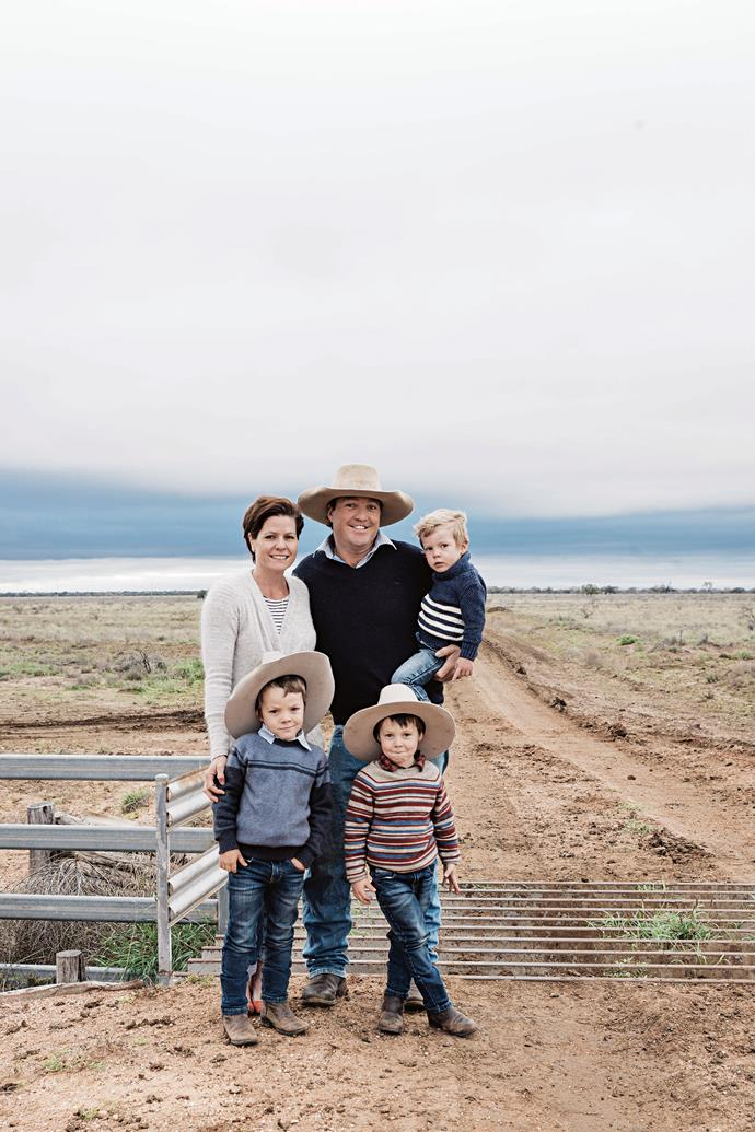 Jayde and Ben Chandler (holding two-year-old Wally) with Jack, five, and Charlie, four, on their 7000-hectare cattle property in western Queensland.