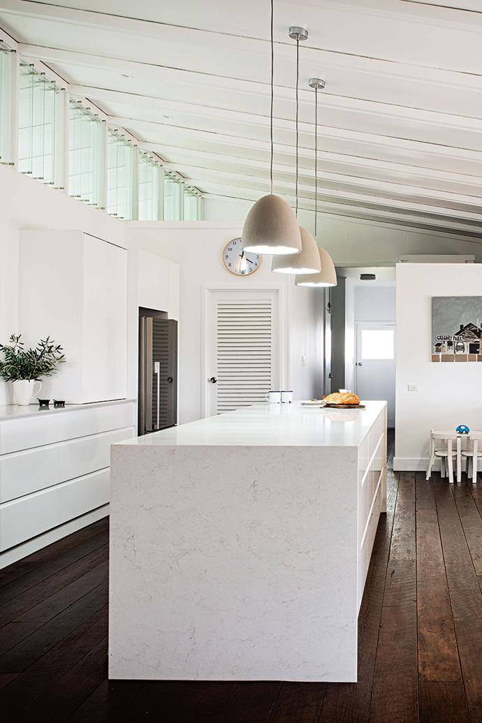 The spacious kitchen is the heart of the home and features a clean, minimalist style designed to withstand living with a brood of boys.