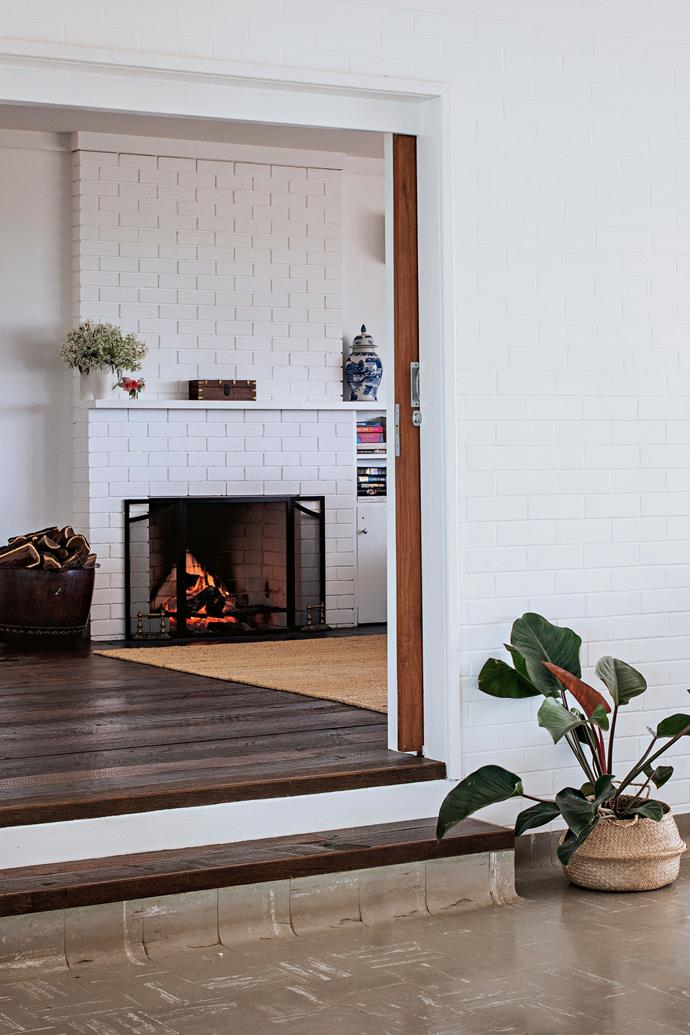 The family room features a wood-burning fireplace.