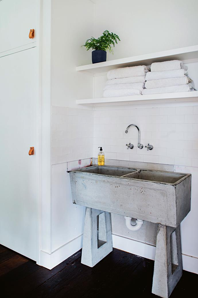 """A concrete sink made by [Everhard Industries](https://www.everhard.com.au target=""""_blank"""" rel=""""nofollow"""") in the mudroom (still a work in progress, says Jayde) facilitates clean up after outdoor work and play."""