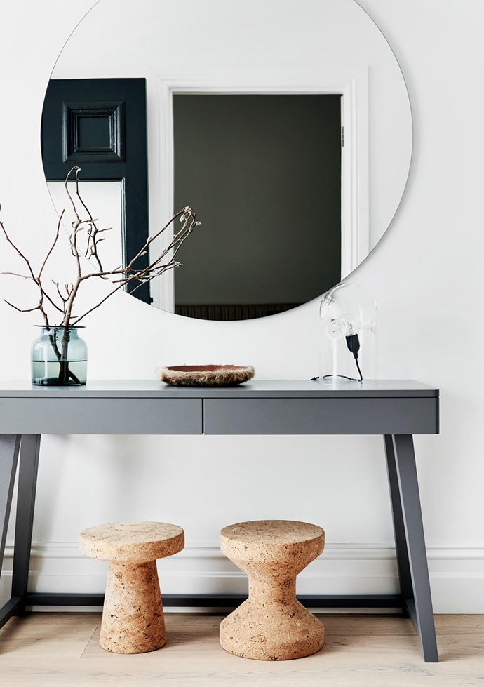 Sitting on a Gervasoni console from Anibou is a vase from Hub and Karakter 'Tripod' table lamp from Cult. 'Orb' mirror from Meizai. Vitra 'Model C' and 'Model A' cork stools from Space.