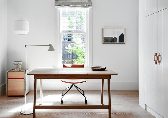 Alki 'Landa' desk from Cafe Culture + Insitu and 'Catifa 46' chair from Stylecraft. Rich Brilliant Willing pendant light from Koda. Louis Poulsen floor lamp from Cult. Artwork by Sophie Westerman from Hub. A pull-down bed is concealed in the cupboards.
