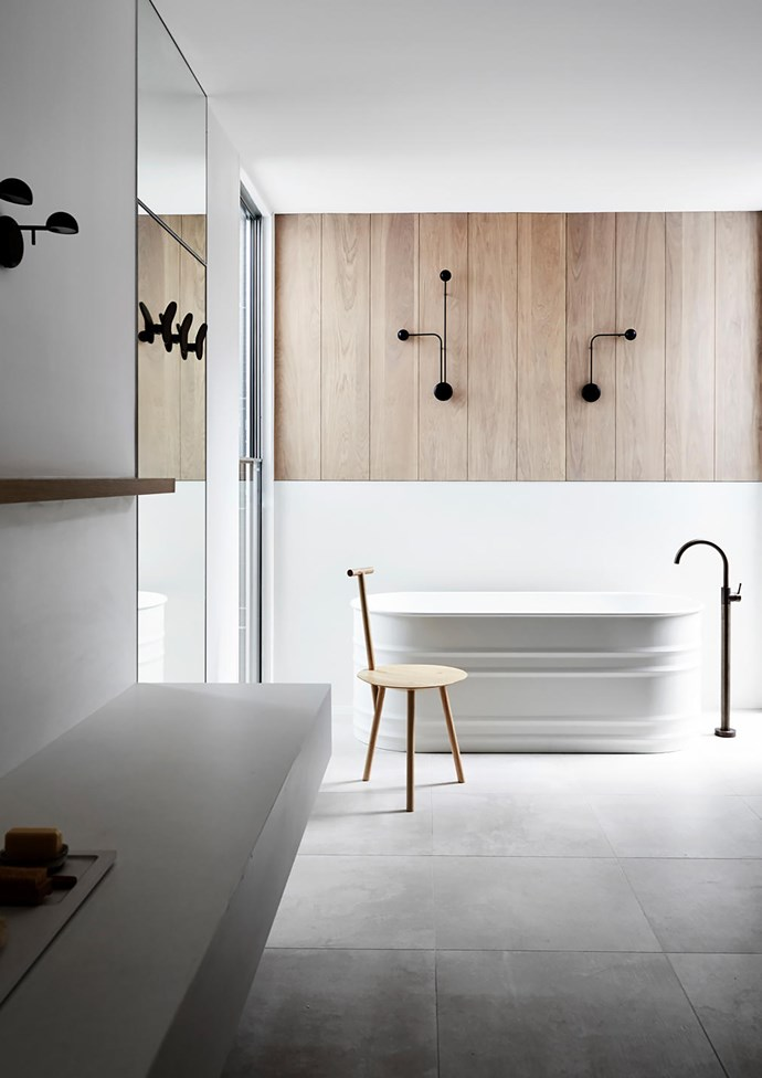 In the family bathroom is an Agape 'Vieques' bath from Artedomus. Vibia 'Pin' wall lights from Koda. Brodware 'Yokato' aged bronze taps. Faye Toogood 'Spade' chair from Hub.