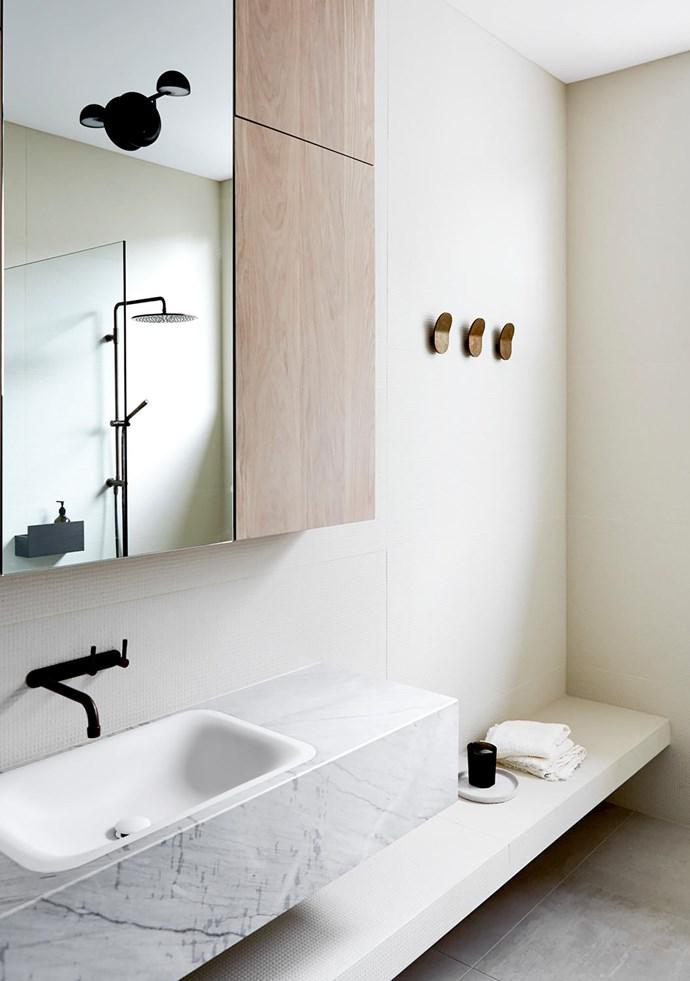 In the main bathroom, Agape 'Ottocento' basin from Artedomus with Brodware 'Yokato' tapware. 'Como' wall hooks from Pittella.