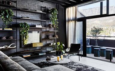 An industrial-style apartment with a dark and moody monochrome palette
