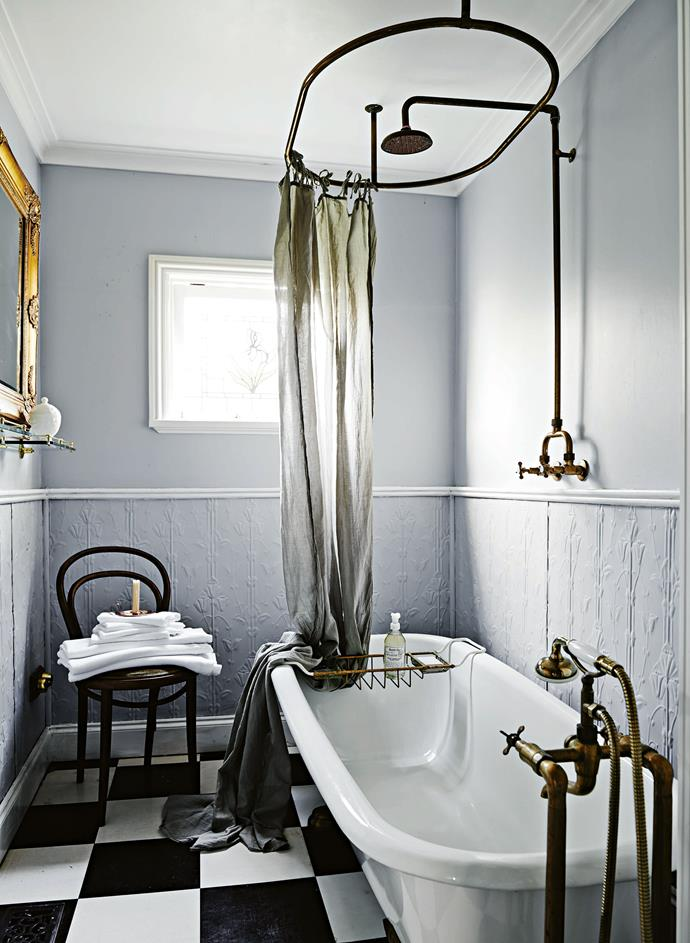 Vintage fittings and a linen shower curtain in the bathroom.