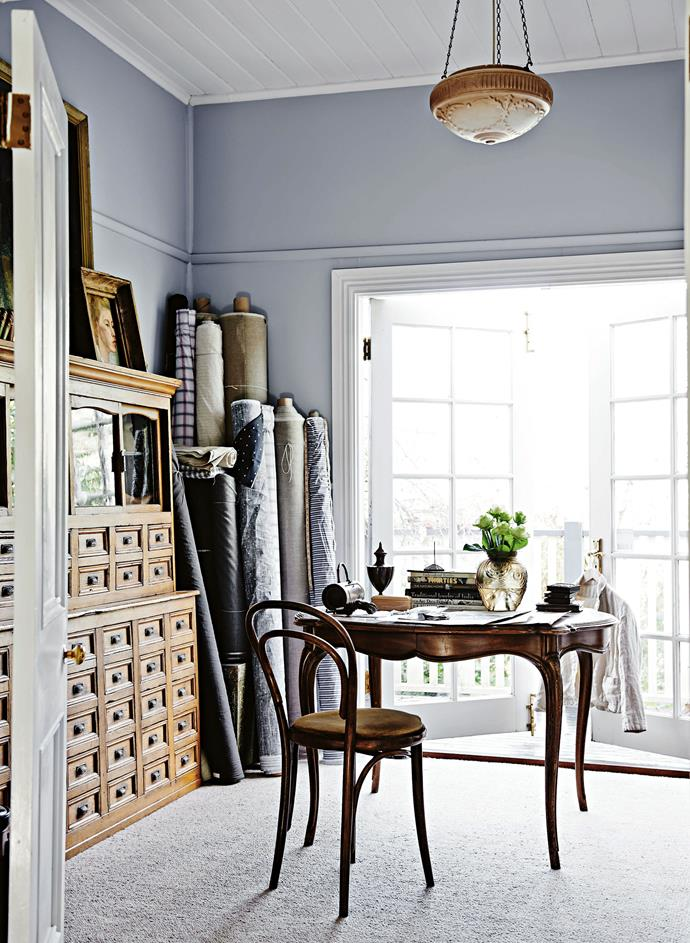 Victoria's home studio features an antique French table and Japanese herbalist chest, and bolts of European fabric.