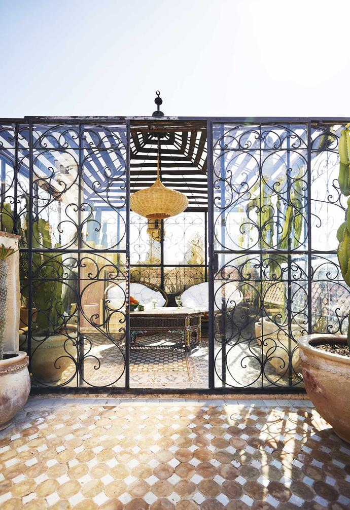 **Bright idea** Enclosed outdoor spaces create a hip retreat. This wrought-iron pavilion also preserves the light and views while fitting in with the home's ornamentation.