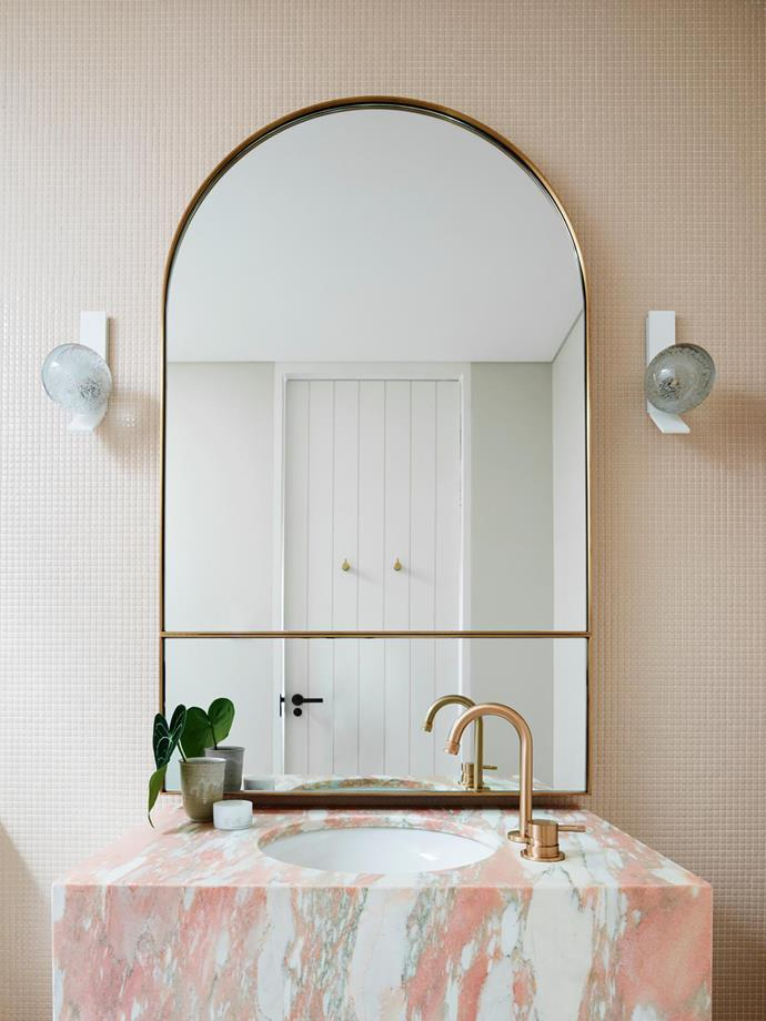 Joinery/Vanity Norwegian Rose marble by CDK Stone. Splashback/wall finish 'Opus Romano' glass mosaic wall tile from Bisanna Tiles. Lighting Articolo 'Fizi' wall sconce in blown glass and powdercoated in White.