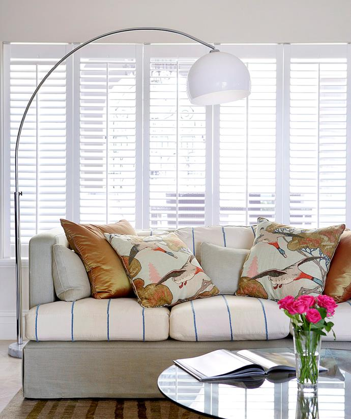 Newly installed white plantation shutters help to complete the transitional style of this living area. *Image: Steve Ryan / bauersyndication.com.au*