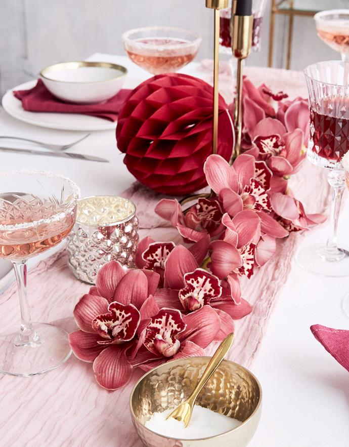 **Choose a colour palette:** Stick to a colour palette rather than an Easter theme when setting the table. Decorations in tonal variations of pink combined with metallic accents creates a pretty and punchy tablescape. *Photo:* Kristina Soljo / *bauersyndication.com.au*