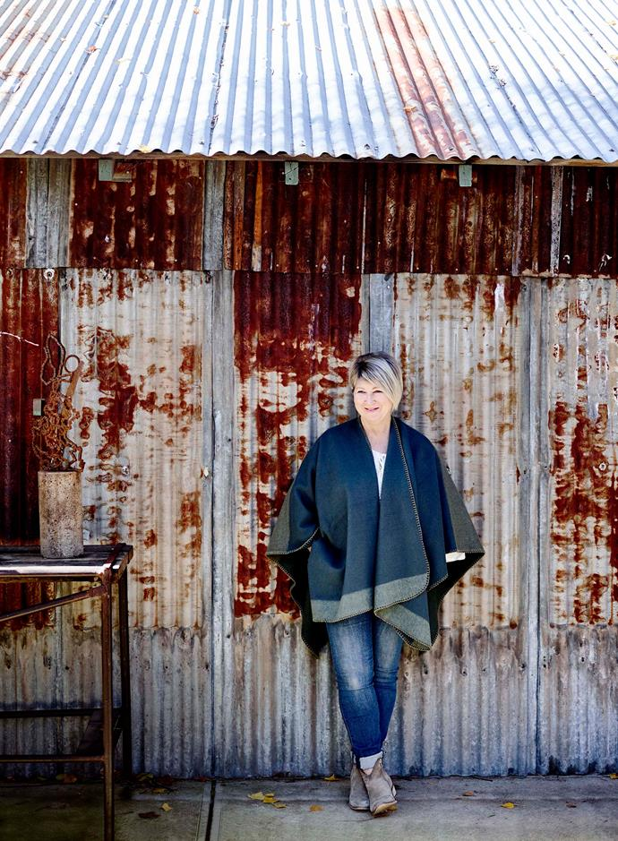 Belinda Satterthwaite outside her husband Stephen's workshop. He crafts sculptures out of old metal that are now sold in Belinda's shop, Tomolly.