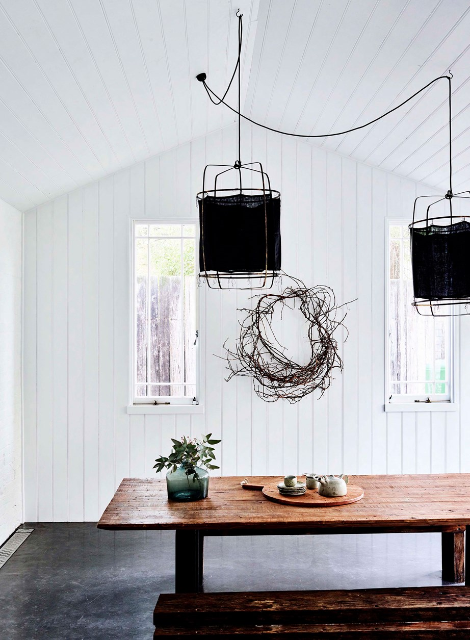 """Of course, a solid farm-style table can be the base of any rustic look, but there's no reason why you can't add modern elements. These MRD Home pendants blend new and old worlds perfectly in this [converted flour mill](https://www.homestolove.com.au/flour-mill-home-conversion-19095