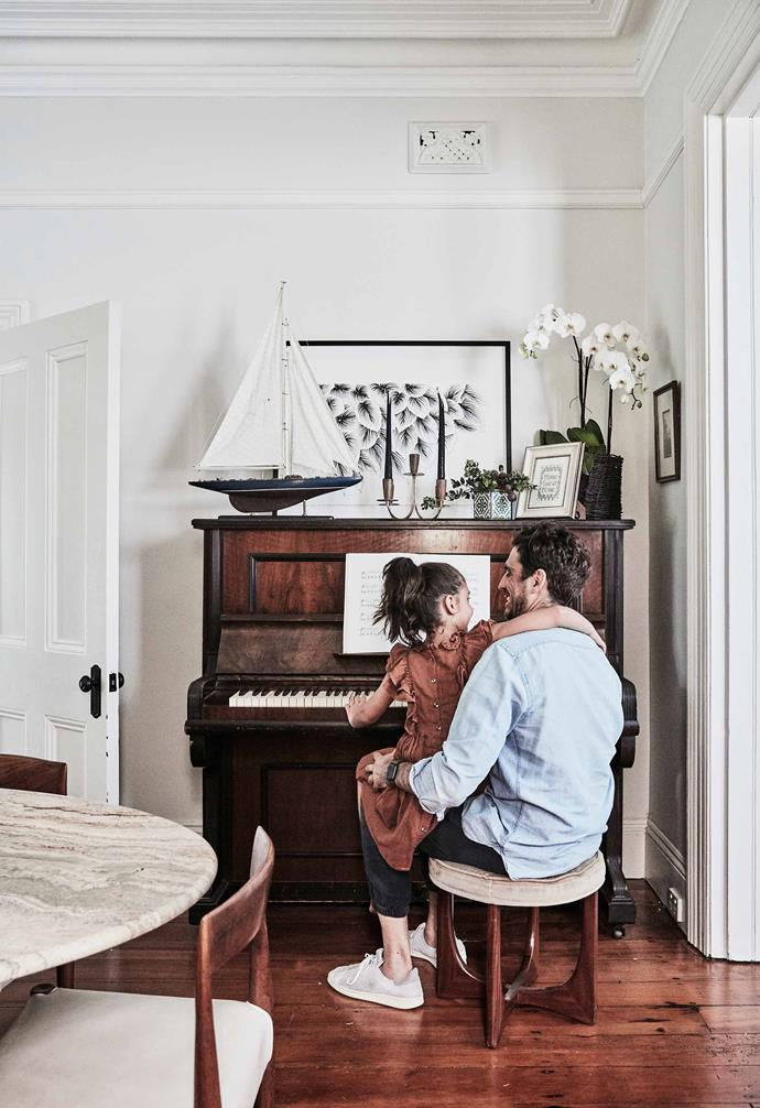**Dining room**  Rafael and Kim play the piano, which is topped with an Adriana Picker illustration and an antique yacht from Lawsons.