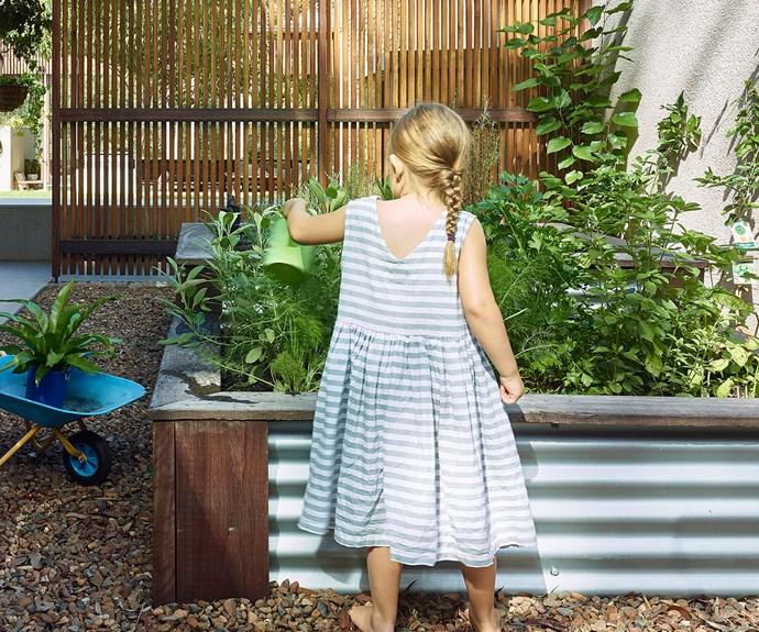 Girl gardening in vegie patch