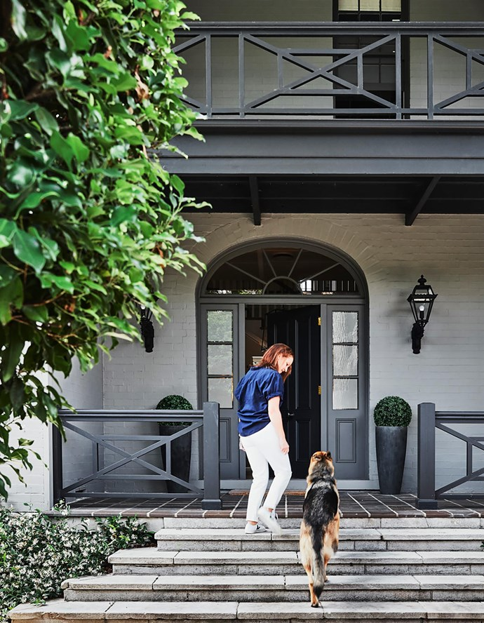Homeowner Andrea Stark with German shepherd Rocco. The front garden was designed by Will Dangar.