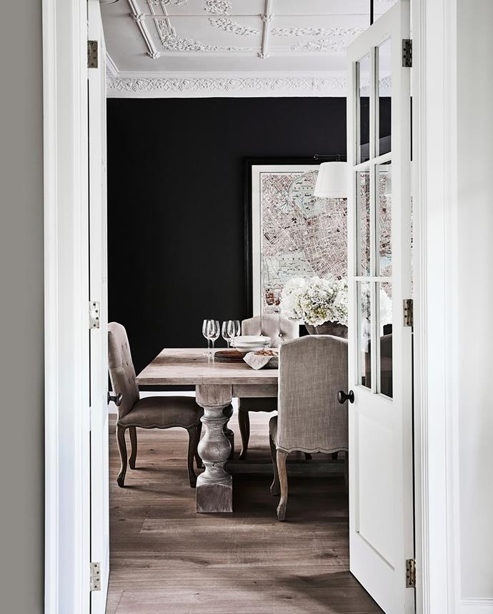 """The original ornate ceiling was retained. The table was handmade by a woodworker in Kent, England. Chairs from La Maison, London. Placemats, Muji. Veron three-light pendant, Magins. London map artwork from Coco Republic. Door hardware, [myknobs.com](https://www.myknobs.com/ target=""""_blank"""" rel=""""nofollow"""")."""